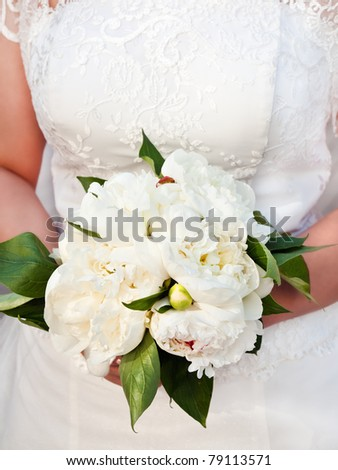 Bride holding bouquet - stock photo