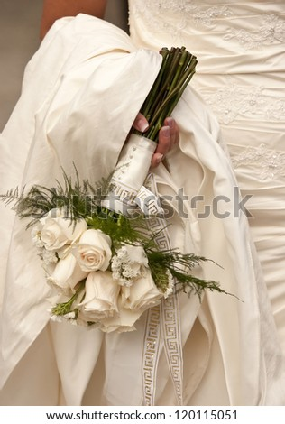 bride holding bouquet of white roses - stock photo