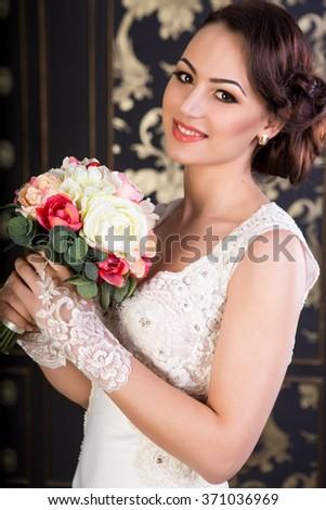 Bride holding bridal bouquet, portrait shot  - stock photo