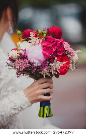 Bride holding bright wedding peony bouquet. Wedding details - stock photo