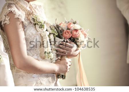 Bride holding her beautiful bouquet - stock photo