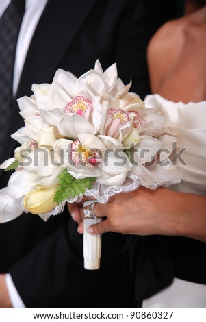 Bride holding her bouquet at the wedding