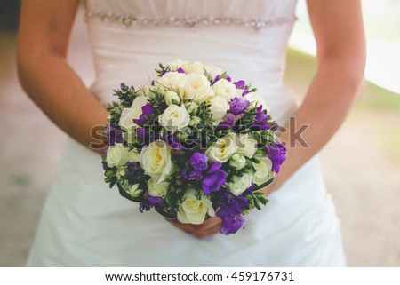 Bride holding in hands wedding bouquet. wedding concept