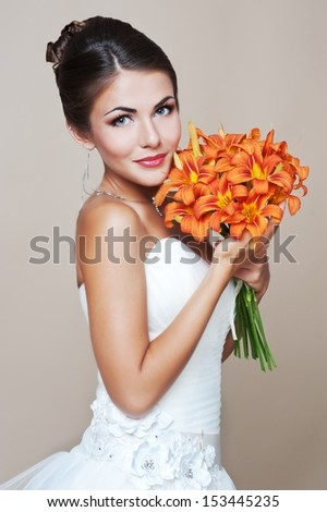Bride holding wedding bouquet. Wedding bouquet of lilies - stock photo