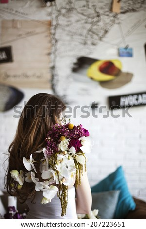 Bride holding wedding bouquet with orchid