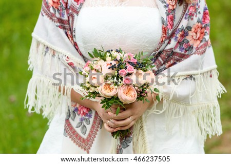Bride Holding Wedding Bouquet with rose