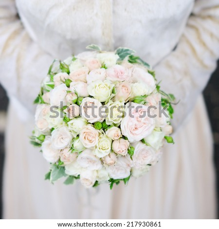Bride holding wedding flowers bouquet