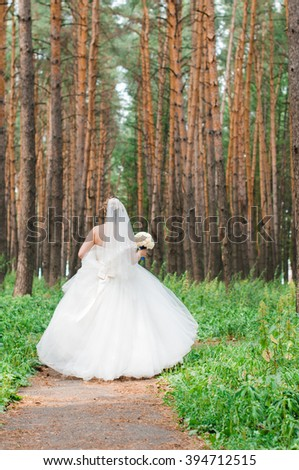 Bride in a pine forest
