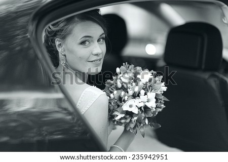bride in a wedding car - stock photo