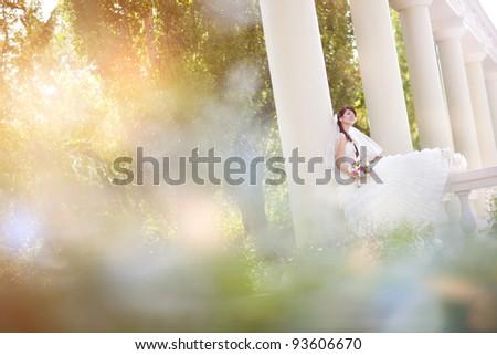 bride in columns - stock photo