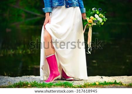 bride in pink gumboots - stock photo