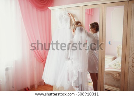 Bride in the robe and a beautiful dress