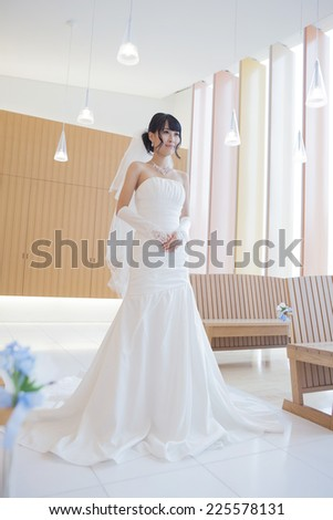 Bride in the wedding dress in the church - stock photo