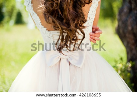 bride in wedding dress with bow - stock photo