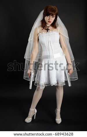 Bride in white dress armed with two pistols - stock photo