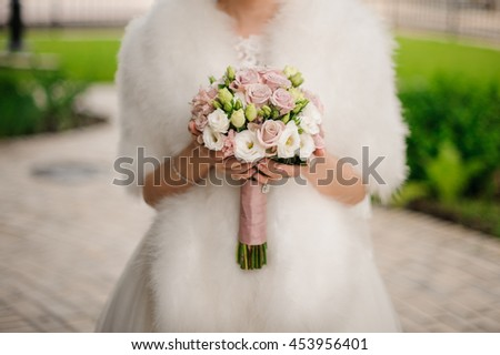 Bride in white dress with wedding bouquet. no face - stock photo