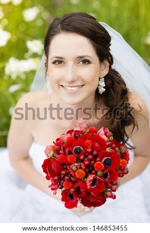 Bride in white wedding dress at the meadow - stock photo