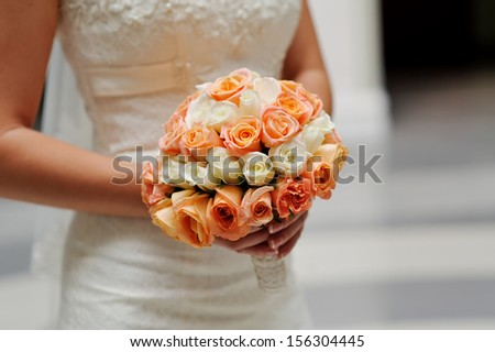Bride is holding a bouquet in hand - stock photo