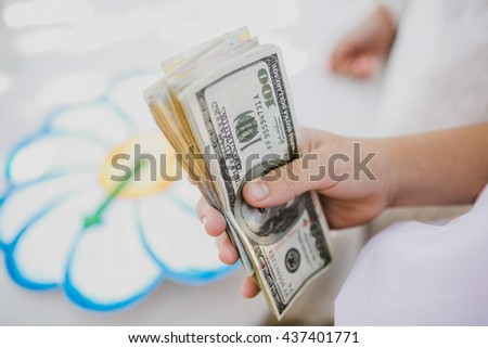 Bride is holding a lot of dollar bills