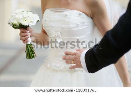 Bride is holding a wedding bouquet - stock photo