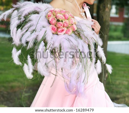 bride is holding flower bouquet at the wedding reception