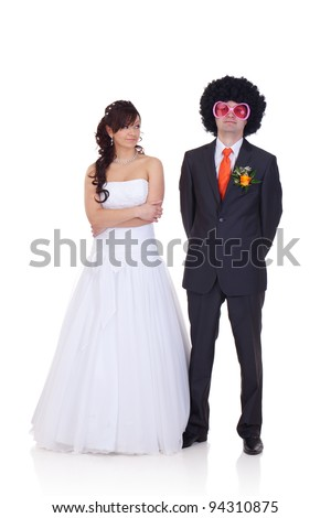 Bride is wondering who is the guy she did marry, because he looks like a disco dancer. - stock photo