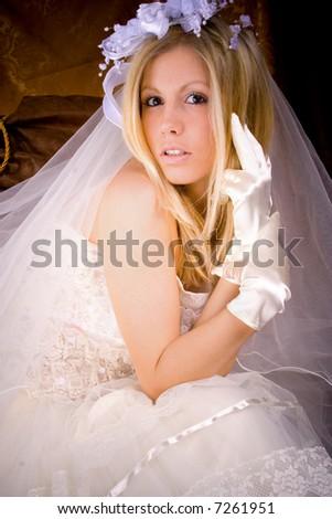 bride lin wedding dress sitting, studio shot, - stock photo