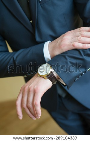 bride looking at hand watch