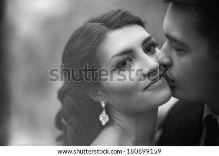bride meets groom on a wedding day, black and white - stock photo