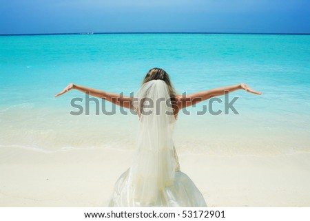 bride on beautiful Maldivian beach - stock photo
