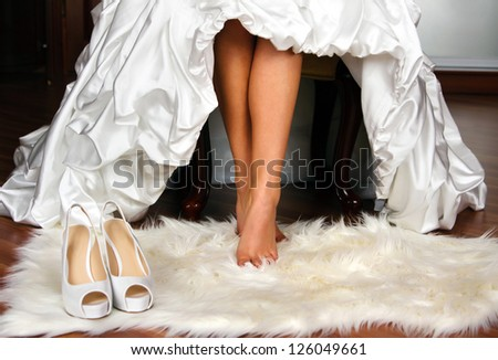 bride on foot mat with shoes - stock photo