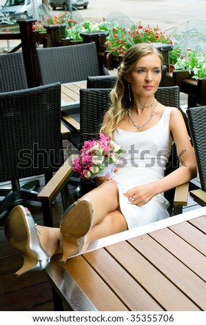Bride on terrace of restaurant. Shallow DOF