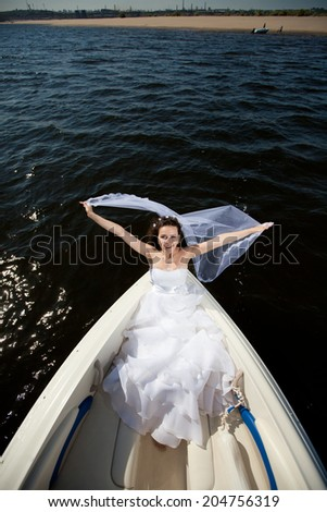 bride on the boat - stock photo