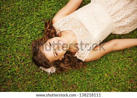 bride on the grass - stock photo