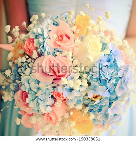 Bride or bridemaid with bouquet, closeup with retro filter effect  - stock photo