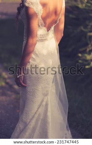 Bride outdoor in wedding dress. Vintage colors - stock photo