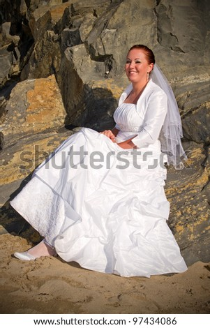 Bride portrait over rocky beach scenery