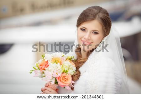 Bride portrait wedding day, young beautiful woman in wedding dress. soft tonality. series - stock photo