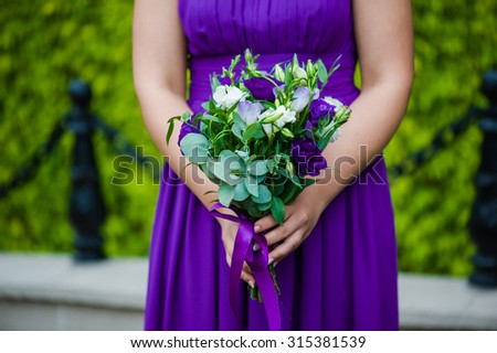 Bride, row of bridesmaids with bouquets at big wedding ceremony. - stock photo