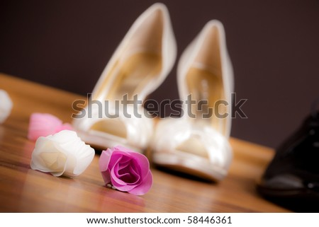 Bride's and groom's shoes - stock photo