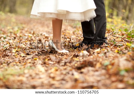 bride's and groom's shoes on the leaves - stock photo