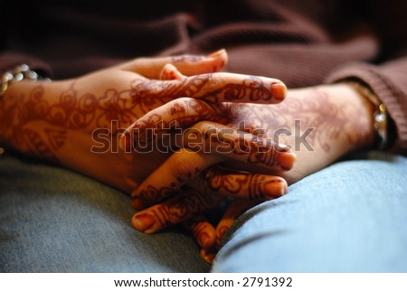 Bride's folding hands II