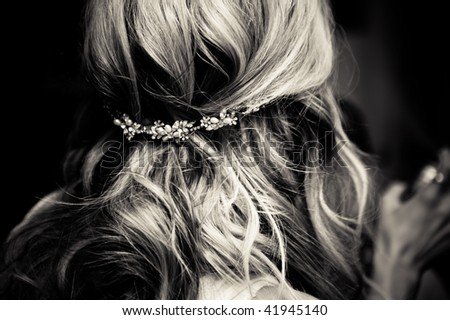 Bride's hair, styled with a hair ornament. - stock photo