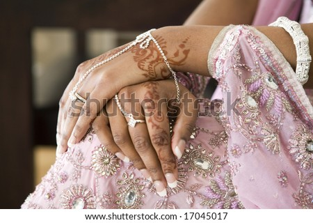 Bride's Hand With Henna Tattoo And Jewellery, Indian Wedding - stock photo