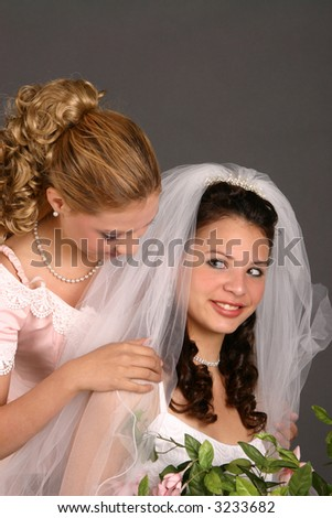 Bride's maid and bride prepare for wedding