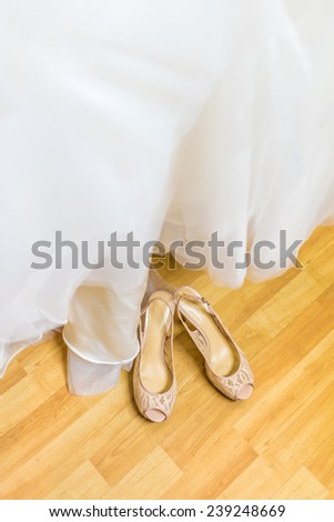 Bride's shoes and the bridal gown
