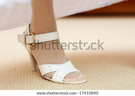 Bride shoes. Leg of young woman in shoes. - stock photo