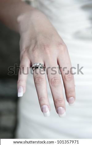 Bride showing engagement and wedding ring - stock photo