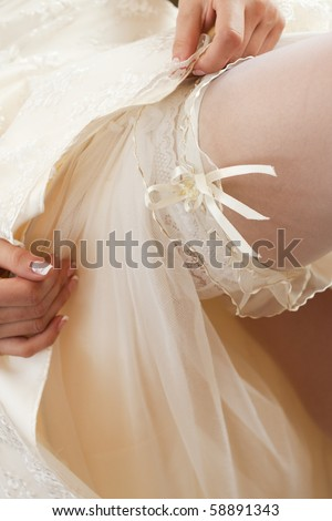 Bride shows us what 39 s under her dress stock photo for Garter under wedding dress