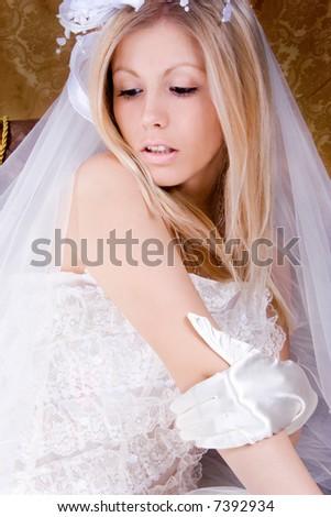 bride sitting in wedding dress, studio shot, - stock photo